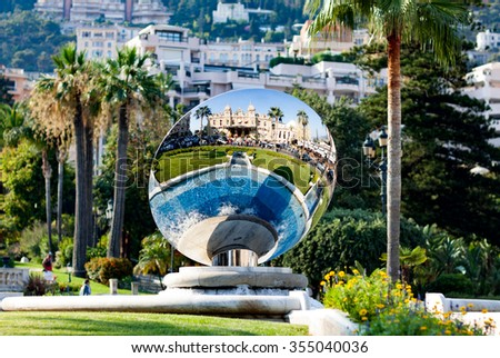 MONTE CARLO, MONACO - AUGUST 14, 2012: View of Monte Carlo, Monaco with Sky Mirror sculpture by Anish Kapoor reflecting casino building
