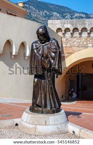 Monte-Carlo, Monaco, France - September 25, 2009: The stone statue of the monk in front of the Royal Palace in the State Monaco