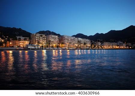 Monte Carlo, Monaco - September 19, 2015: night view of city resort on sea coast with beautiful illumination on seascape background - stock photo