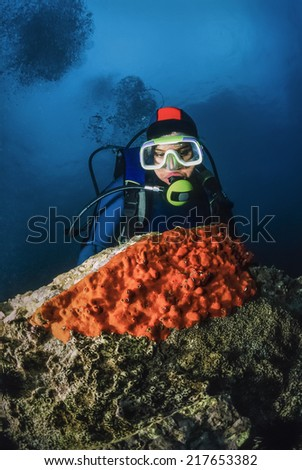 Montenegro, Adriatic Sea, U.W. photo, diver and red sponges on a rock - FILM SCAN - stock photo