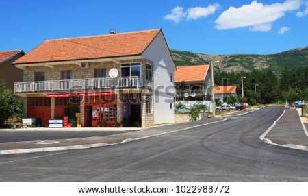 MONTENEGRO. BUDVA - JUNE 19, 2017: A picturesque view of a modern village and the road in the background of the Balkan mountains on a summer day.