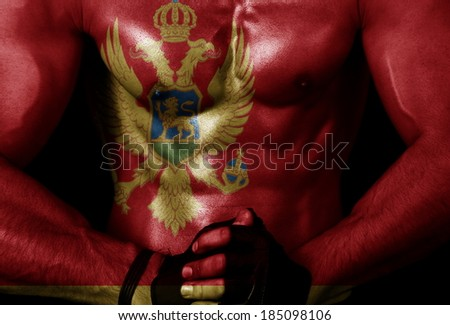 Montenegro flag on sporty male body