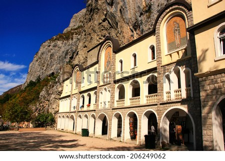 MONTENEGRO - OCTOBER 22: Facade of Upper Church with mosaics on October 22, 2010 in Ostrog monastery, Montenegro. Ostrog monastery is the most popular pilgrimage place in Montenegro. - stock photo