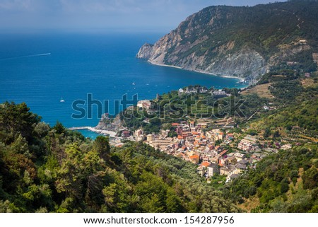 MONTEROSSO AL MARE, ITALY - JULY 24, 2013: Coastal Cinque Terre village and resort on July 24, 2013 in Monterosso al Mare, Italy. - stock photo
