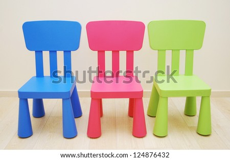 Montessori Kindergarten Preschool Classroom with table and three chairs - stock photo