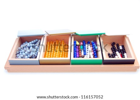 Montessori material - colored beads on white background with container