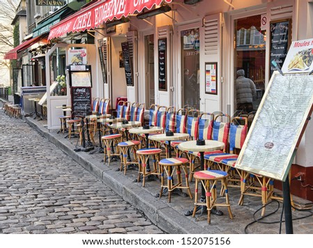 MONTMARTRE - DEC 13 : Artists easels and artwork set up in Place du Tertre in Montmartre, Paris on December 13, 2012. Montmartre attracted many famous modern painters in the early 20th century - stock photo