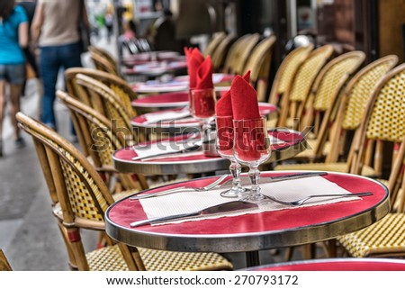 Montmartre restaurant with people walking. - stock photo