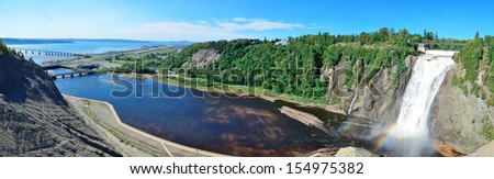 Montmorency Falls panorama with rainbow and blue sky near Quebec City. - stock photo