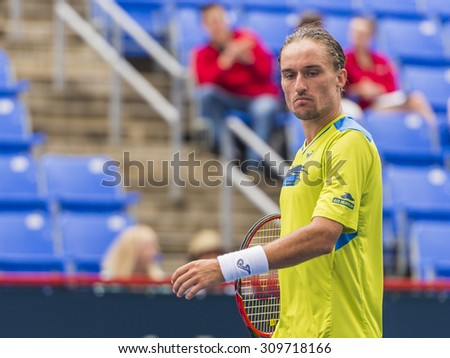MONTREAL - AUGUST 11: Alexandr Dolgopolov of Ukraine during his first round loss to Grigor Dimitrov of Bulgaria at the 2015 Rogers Cup on August 11, 2015 in Montreal, Canada
