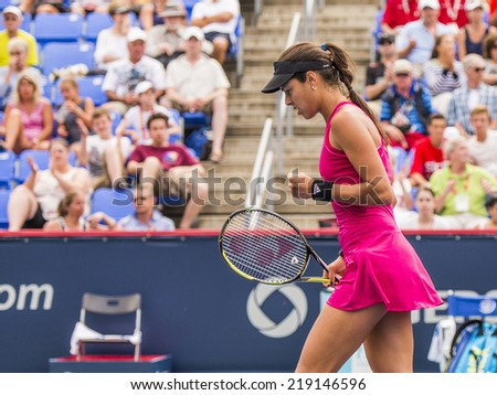 MONTREAL - AUGUST 5: Ana Ivanovic of Serbia in her Second round win over Timea Bacsinszky of Switzerland at the 2014 Rogers Cup on August 5, 2014 in Montreal, Canada - stock photo