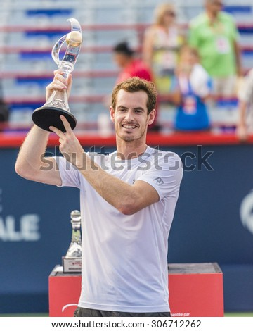 MONTREAL - AUGUST 16:   Andy Murray of Great Britain with his trophy after winning his final match against Novak Djokovic of Serbia at the 2015 Rogers Cup on August 16, 2015 in Montreal, Canada - stock photo