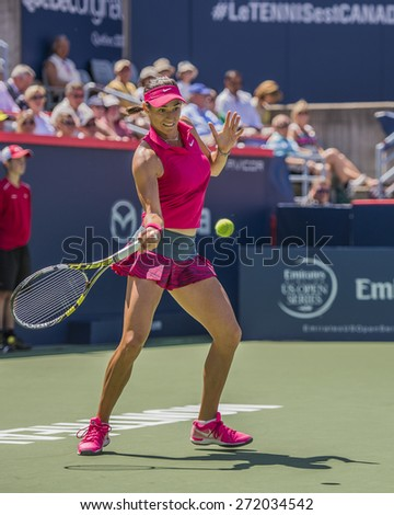 MONTREAL - AUGUST 6: Caroline Garcia of France in her Second round match against Angelique Kerber of Germany at the 2014 Rogers Cup on August 6, 2014 in Montreal, Canada