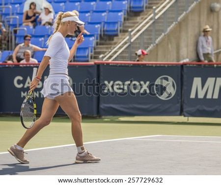 MONTREAL - AUGUST 5: Caroline Wozniacki of Denmark in her Second round match win over Daniela Hantuchova of Slovakia at the 2014 Rogers Cup on August 5, 2014 in Montreal, Canada - stock photo