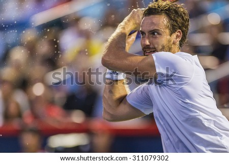 MONTREAL - AUGUST 14: Ernests Gulbis of Latvia during his quarter final match loss to Novak Djokovic of Serbia at the 2015 Rogers Cup on August 14, 2015 in Montreal, Canada  - stock photo