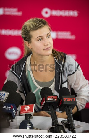 MONTREAL - AUGUST 3: Eugenie Bouchard of Canada during press conference at the 2014 Rogers Cup on August 3, 2014 in Montreal, Canada - stock photo
