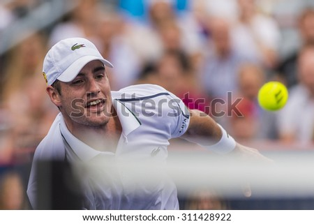 MONTREAL - AUGUST 14: John Isner of USA during his quarter final match loss to Jeremy Chardy France at the 2015 Rogers Cup on August 14, 2015 in Montreal, Canada