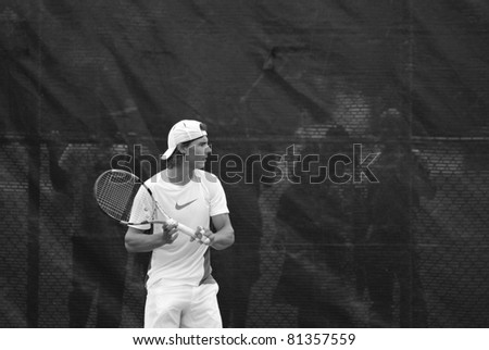 """MONTREAL - AUGUST 5:Raphael Nadal on training court of Montreal Rogers Cup on August 5, 2009 in Montreal, Canada. Rafael """"Rafa"""" Nada is a Spanish professional tennis player and a former World No. 1. - stock photo"""