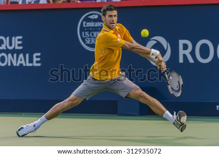 MONTREAL - AUGUST 11: Thomaz Bellucci of Brazil during his second round match loss to Novak Djokovic of Serbia at the 2015 Rogers Cup on August 11, 2015 in Montreal, Canada  - stock photo