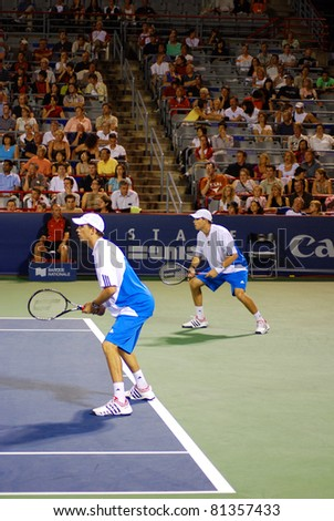 MONTREAL - AUGUST 5:Twin brothers Robert Bryan and Michael Bryan on  court at Montreal Rogers Cup on August 12, 2009 in Montreal, Canada.Twin brothers are American professional tennis players. - stock photo