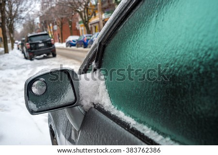 Montreal, CA, 29th February 2016. Car mirror and windows are covered with ice after icy rain.