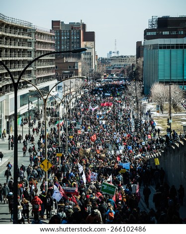 MONTREAL, CANADA   APRIL 02 2015: Riot in the Montreal Streets to counter the Economic Austerity Measures. Panoramic View (XXXL Resolution) of the Streets Packed with Protesters - stock photo