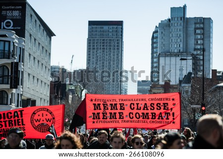 MONTREAL, CANADA   APRIL 02 2015: Riot in the Montreal Streets to counter the Economic Austerity Measures. Protesters Takes the control of the Streets - stock photo