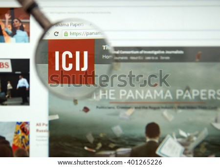 MONTREAL, CANADA - APRIL 5, 2016 : The Panama Papers web page under magnifying glass. It's a leaked set of 11.5 million confidential documents. - stock photo