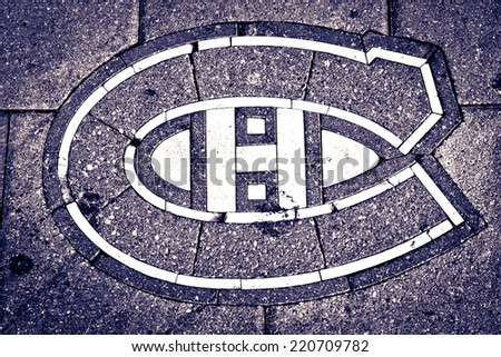 MONTREAL CANADA AUGUST 21: Canadien hockey team crest print into the pavement in front of Bell center in Montreal, August 21, 2014. - stock photo