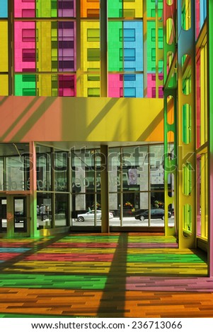 MONTREAL, CANADA - AUGUST 20 2014: Interior of congress center in Montreal downtown with multicolored glass panel created by Mario Saia in 2002 - stock photo