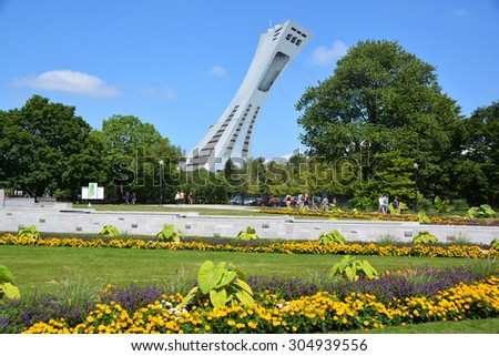 MONTREAL,CANADA -AUGUST 08 2015. The Montreal Olympic Stadium and tower. It's the tallest inclined tower in the world.Tour Olympique stands 175 meters tall and at a 45-degree angle  - stock photo