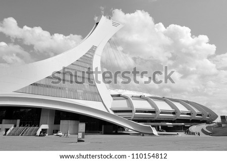 MONTREAL,CANADA -AUGUST 8. The Montreal Olympic Stadium and tower on August, 08 , 2012. It's the tallest inclined tower in the world.Tour Olympique stands 175 meters tall and at a 45-degree angle - stock photo