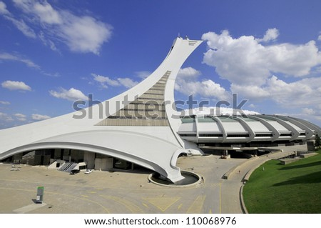 MONTREAL,CANADA -AUGUST 12. The Montreal Olympic Stadium tower on August, 08 , 2012. It's the tallest inclined tower in the world.Tour Olympique stands 175 meters tall and at a 45-degree angle - stock photo