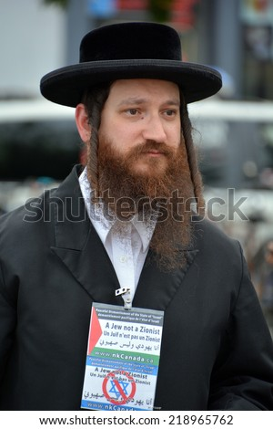 MONTREAL CANADA AUGUST 21:Unidentified man from jewish Hasidic Orthodox Judaism, participating in a rally to condemn the Israel occupation an bombing on Gaza On 08 21 2014 in Montreal Quebec Canada - stock photo