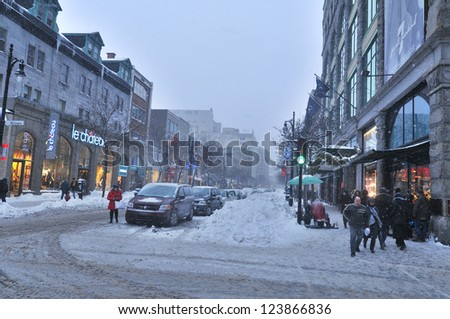 MONTREAL-CANADA DEC. 27:Cars cover of snow on St-Catherine Street. The snow storm slam Montreal with 45 cm of snow, Canada on Dec. 27, 2012 after knocking out power to thousands of homes in the U.S.. - stock photo