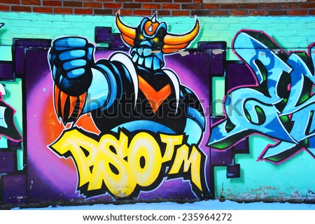 MONTREAL CANADA DEC 02: Street art Montreal  Grendize ron dec 02 2014 in Montreal Canada. Montreal. is the perfect place to walk in the back alleys and abandoned areas, looking for street art. - stock photo