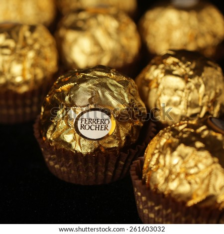 "MONTREAL, CANADA - FEBRUARY 05, 2015: Ferrero Rocher is a chocolate sweet made by Italian Ferrero Spa. Rocher comes from French and means ""rock"" after a grotto in the Roman Catholic shrine of Lourdes. - stock photo"