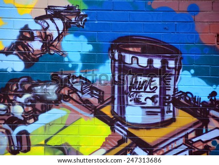 MONTREAL CANADA JANUARY 25: Street art Montreal paint can on january 25 2015 in Montreal Canada. Montreal. is the perfect place to walk in the back alleys and abandoned areas, looking for street art.  - stock photo