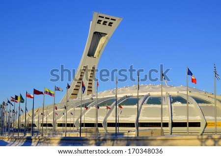 MONTREAL,CANADA - JANUARY 3.The Montreal Olympic Stadium and tower on January 3 , 2013. It's the tallest inclined tower in the world.Tour Olympique stands 175 meters tall and at a 45-degree angle - stock photo