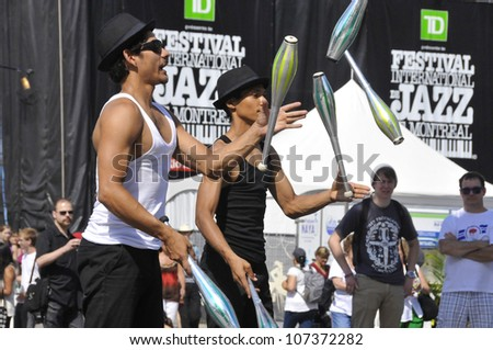 MONTREAL-CANADA JUL 08:Jugglers entertain people a the Montreal Jazz Festival on 2012-07-08 Montreal Canada.Montreal Jazz Fest holds the 2004 Guinness World Record as the world's largest jazz festival - stock photo