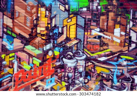 MONTREAL CANADA JULY 25 2015: Street art paint Montreal is the perfect place to walk in the back alleys and abandoned areas, looking for street art. - stock photo