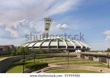 MONTREAL,CANADA -JUNE 24.The Montreal Olympic Stadium on June 24 , 2008. It's the tallest inclined tower in the world.Olympic tower stands 175 meters tall and at a 45-degree angle. - stock photo