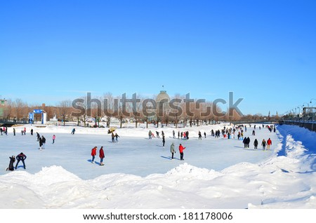 MONTREAL CANADA MARCH 09: Old port ice rink artificial surface of ice, incredible views of historic Old-Montreal and the river on march 09 2014 in Montreal Quebec, Canada - stock photo