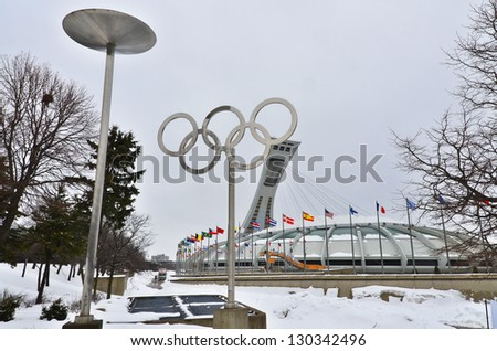 MONTREAL,CANADA - MARCH.3.The Montreal Olympic Stadium and tower on March 3 , 2013. It's the tallest inclined tower in the world.Tour Olympique stands 175 meters tall and at a 45-degree angle - stock photo