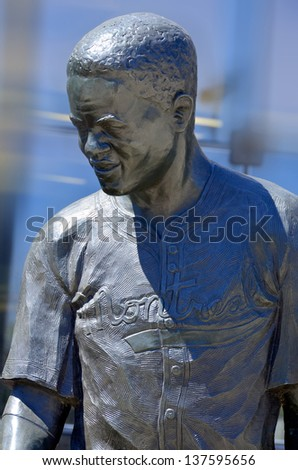 MONTREAL CANADA MAY 5: Bronze statue of Jackie Robinson American baseball player who became the first African American to play in Major League Baseball (MLB). On may 5 2013 in Montreal Canada - stock photo