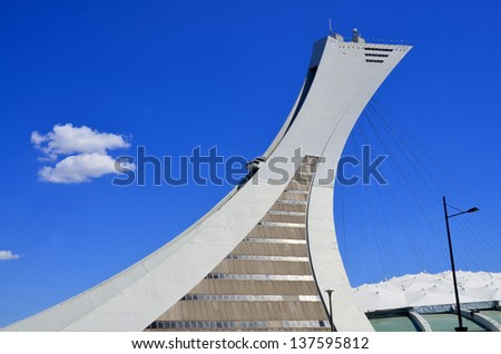 MONTREAL,CANADA -MAY.5.The Montreal Olympic Stadium and tower on may 5 , 2013. It's the tallest inclined tower in the world.Tour Olympique stands 175 meters tall and at a 45-degree angle