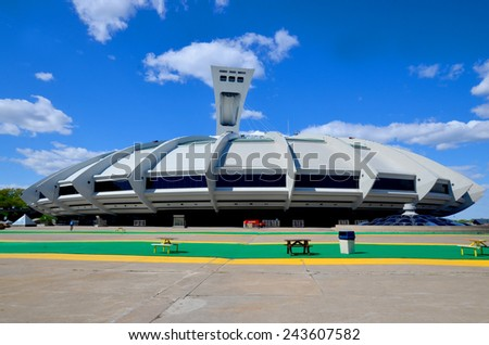 MONTREAL CANADA MAY 15: The Montreal Olympic Stadium and tower on May 15 2013. It's the tallest inclined tower in the world.Tour Olympique stands 175 meters tall and at a 45-degree angle - stock photo