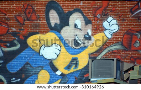 MONTREAL,CANADA QUEBEC AUGUST 22 2015: Street art atonik mouse Montreal is the perfect place to walk in the back alleys and abandoned areas, looking for street art.