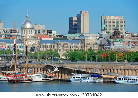 MONTREAL, CANADA - SEP 8: Montreal buildings over river on September 8, 2012 in Montreal, Canada. Montreal is the largest in Quebec, the second-largest in Canada and the 15th-largest in North America. - stock photo