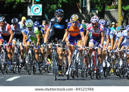 MONTREAL, CANADA-SEPTEMBER 11: A group of cyclists in action  in 2011 UCI cycling calendar | 2011 Grand Prix Cycliste de Montréal on September 11, 2011 in Montreal, Mount royal climb - stock photo